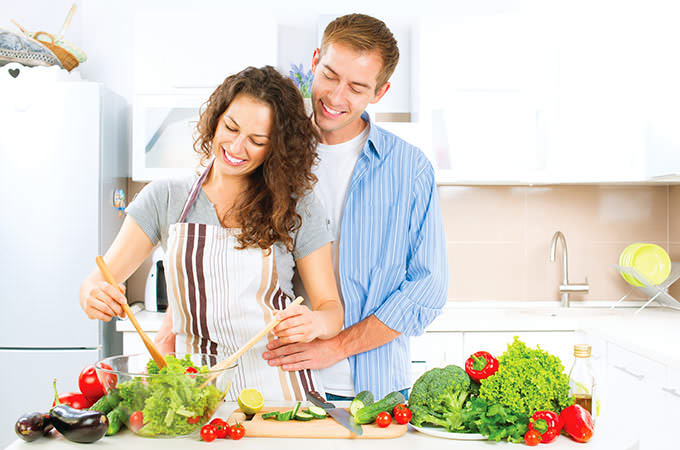 bigstock-Happy-Couple-Cooking-Together--73071298