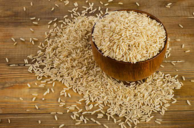 bigstock-Uncooked-Brown-Rice-In-A-Woode-90986588