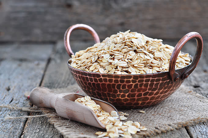 bigstock-oat-flakes-in-a-copper-plate-o-94531916