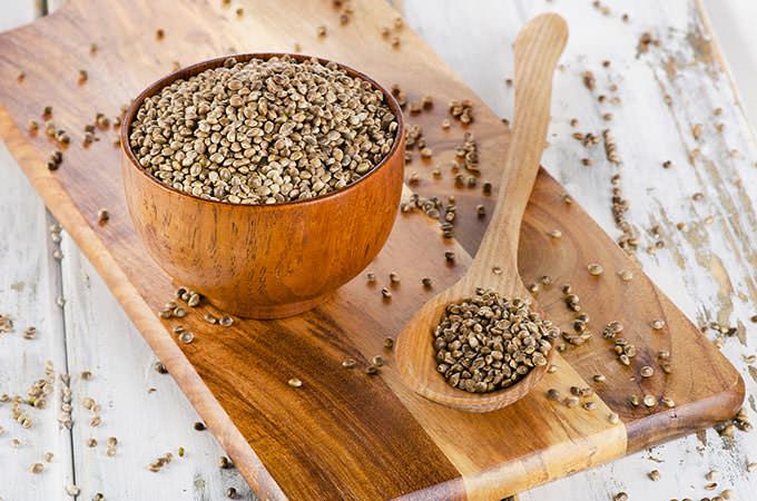 bigstock-Hemp-Seeds-On-Wooden-Board--104747201