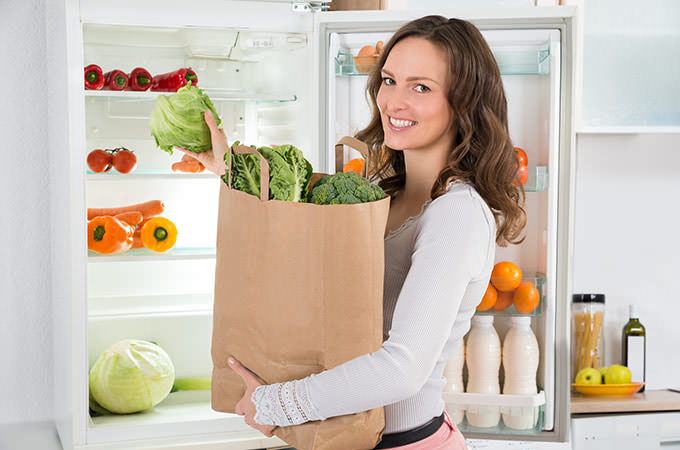 bigstock-Woman-Holding-Shopping-Bag-Wit-98663576