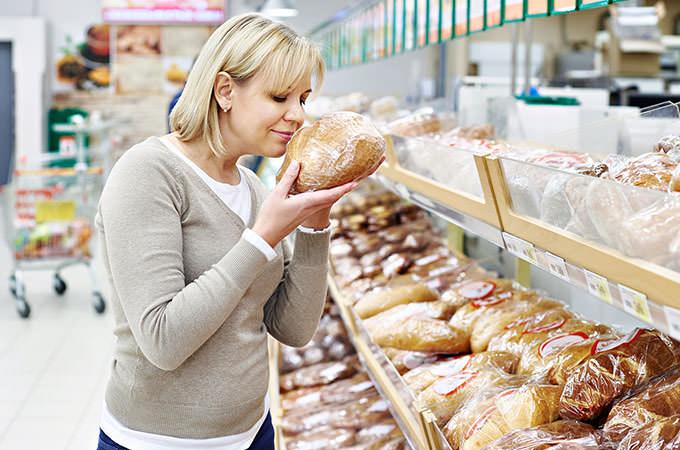 bigstock-Women-Choosing-Bread-In-Shop-98706119