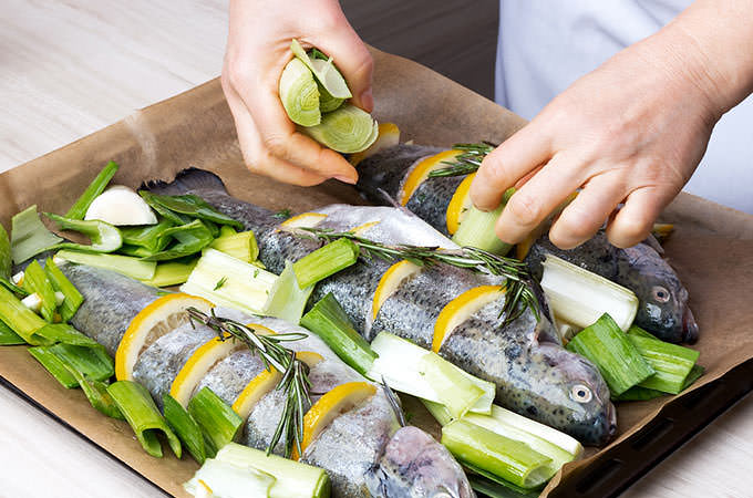 bigstock-Cooking-trout-fish-with-lemon--84860864