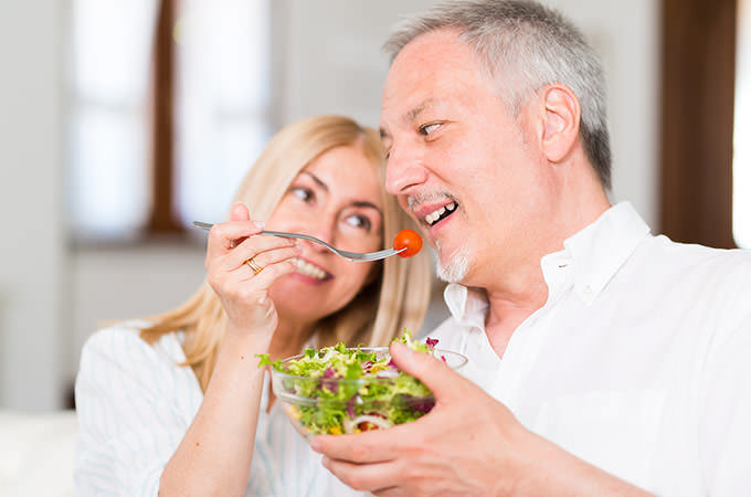 bigstock-Mature-couple-eating-a-salad-i-94099700