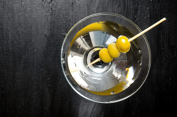 bigstock-martini-with-olives-on-a-black-115281827